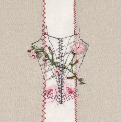 Embroidered bodice overlaid with embroidered pink and red flower on green leaved stems.