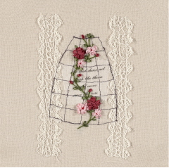 Embroidered Crinoline of a weaving bunch of red and pink flowers on a wire framed crinoline structure.