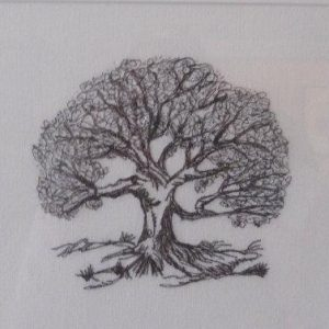 Embroidered individual oak tree on white napkin with black thread.
