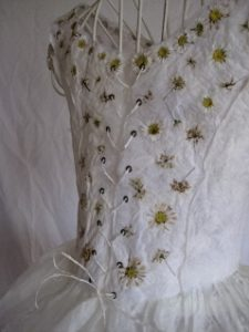 Compete view of embroidered paper dress with draw cord and embroidered daisy and cornflower heads