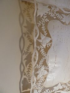 Detailing of left hand side of Embroided Pianola Music Roll.